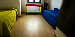 camera letti singoli con culla